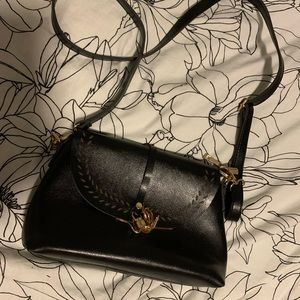 100% vegan black leather bag with gold accents